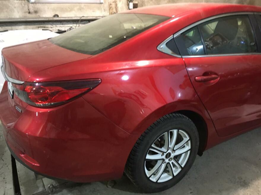 Фото результата ремонта вмятияны без покраски Mazda 6